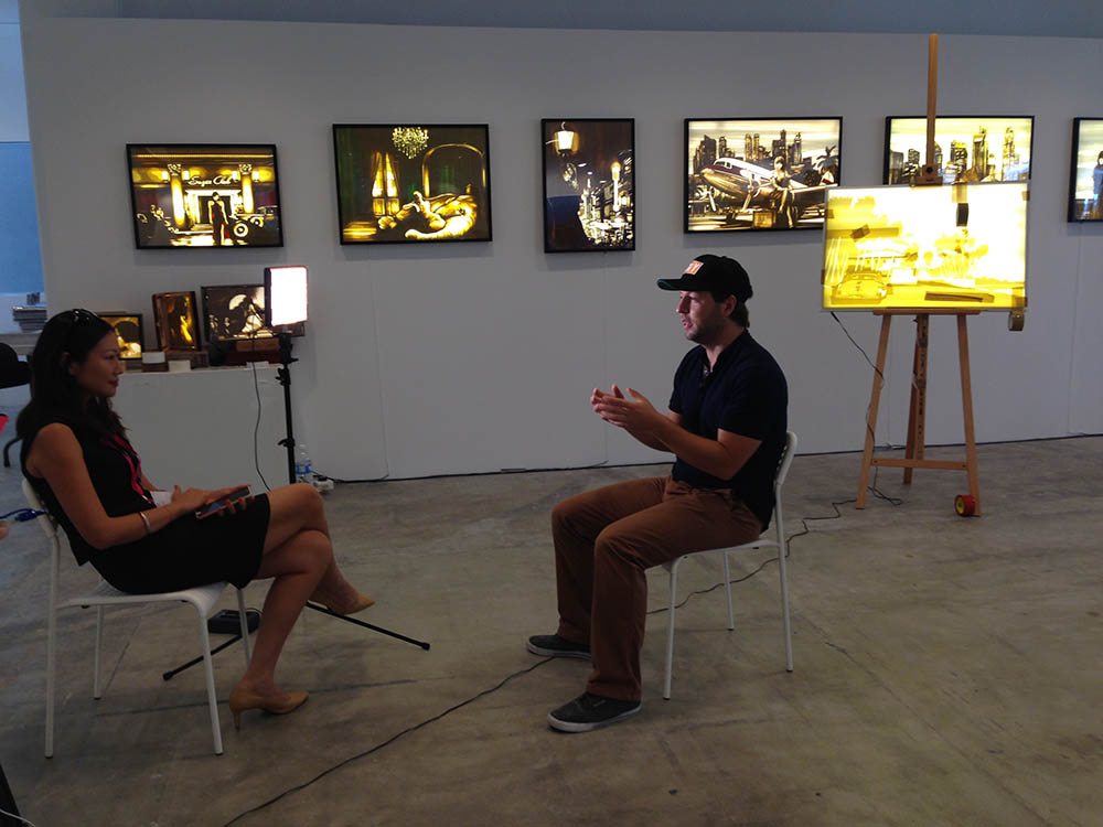 Max Zorn at the Affordable art fair of Singapore, making live tape-art, BBC interview