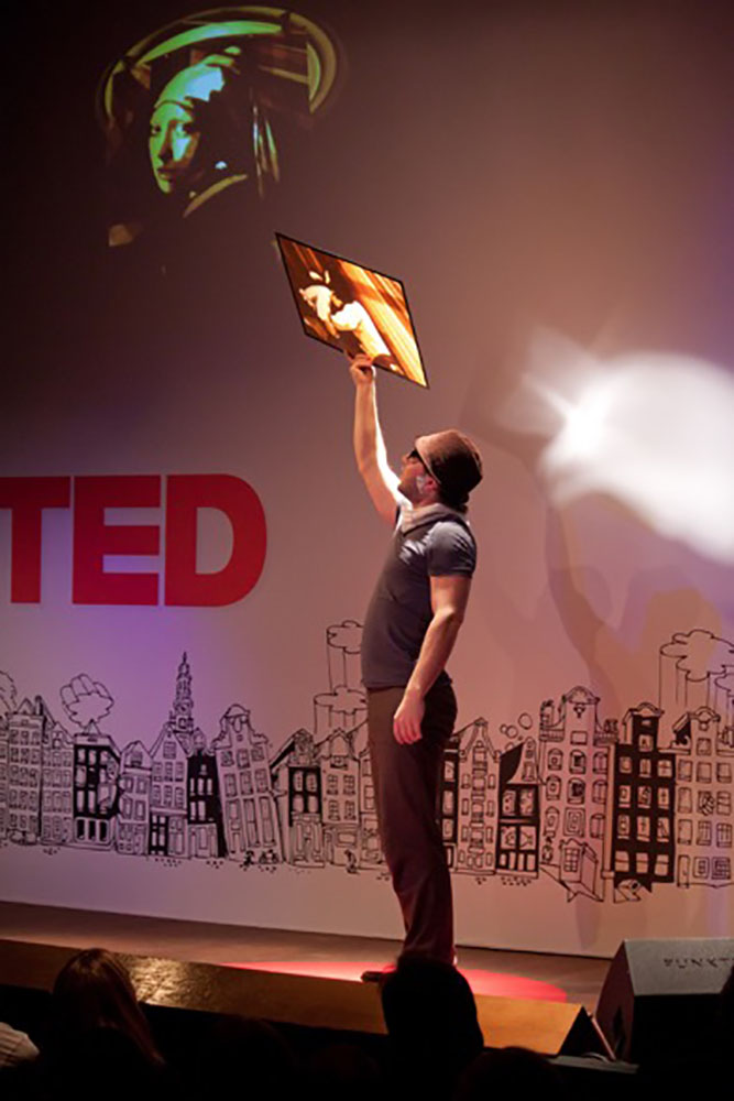 Max zorn at Ted talks showing off a piece of tape art